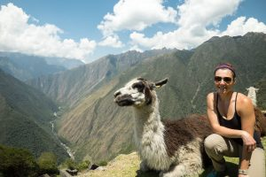 Woman and llama at Machu Pichu, Peru